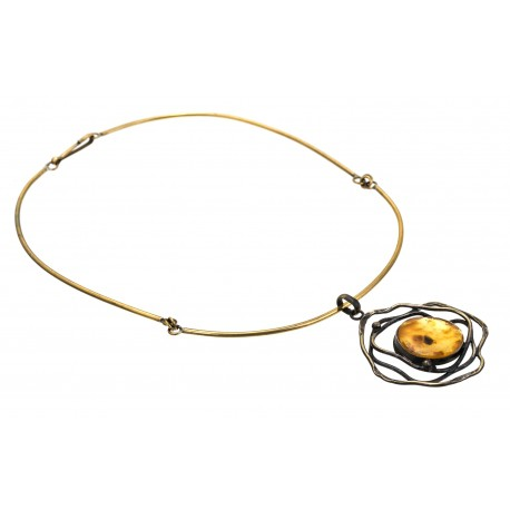 Brass necklace decorated with tracery ornaments and a clear lemon amber