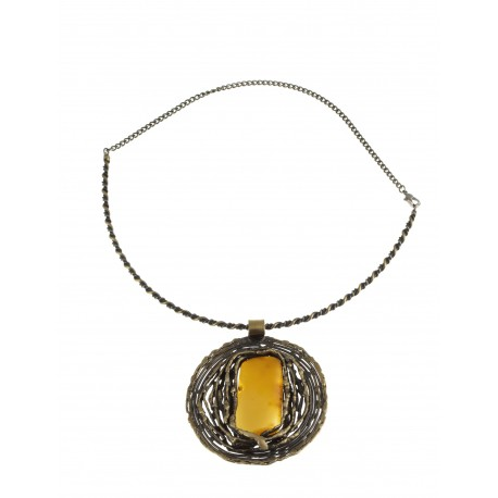 Brass necklace decorated with tracery ornaments and a clear brown amber