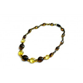 Contrastive transparent yellow lemon and moss colors' amber pieces