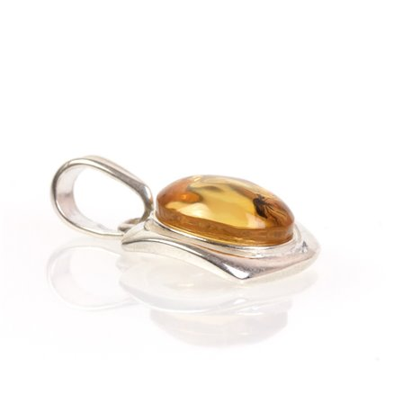 Silver - amber pendant with an inclusion