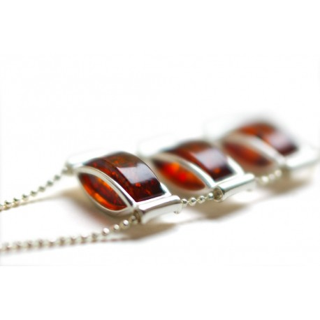 Silver necklace with a dark cognac-colored amber