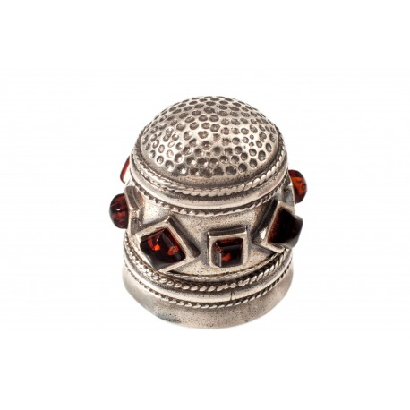 Silver thimble decorated with amber