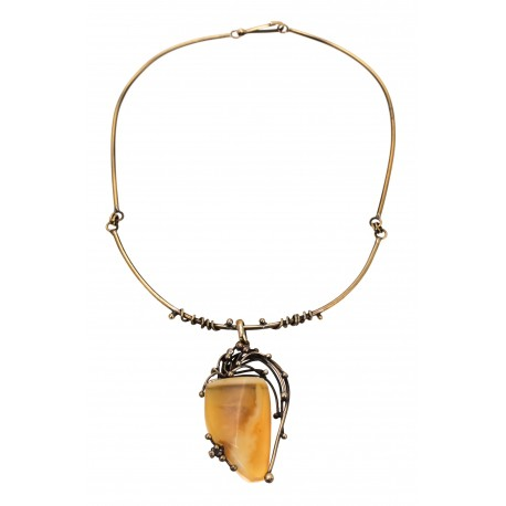 Brass necklace decorated with tracery ornaments and transparent lemon-colored amber