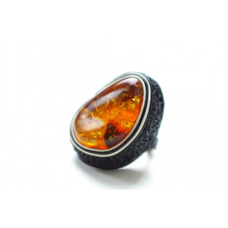 Black leather ring with light cognac-colored amber framed in white leather strings