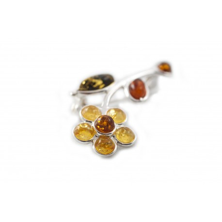 Silver brooch with three-colored amber