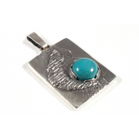 Silver pendant with turquoise inlay