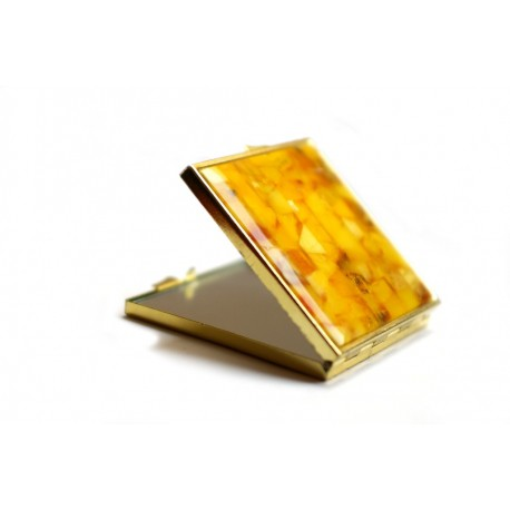 Hand mirror decorated with matted yellow amber