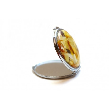 Hand mirror decorated with the Baltic amber