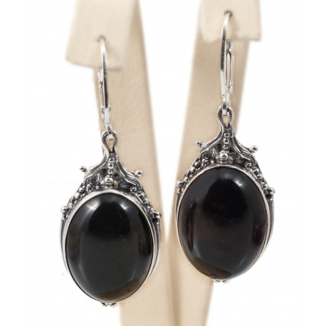 Silver earrings with dark amber