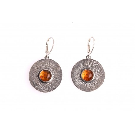 Forged silver earrings with cognac amber