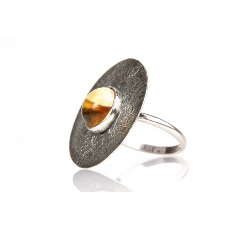 Blackened silver ring with landscaped amber