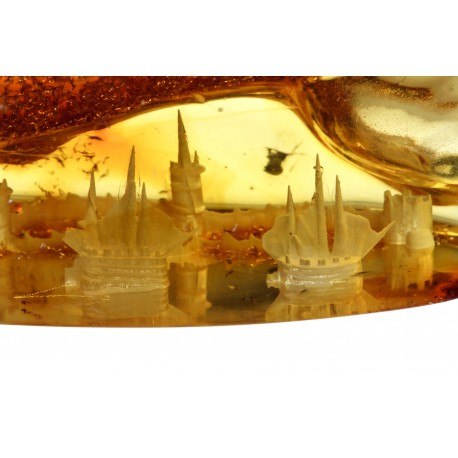 Clear yellow piece of amber with a fortress' panorama