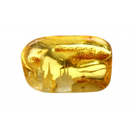 Piece of amber with a fortress' panorama