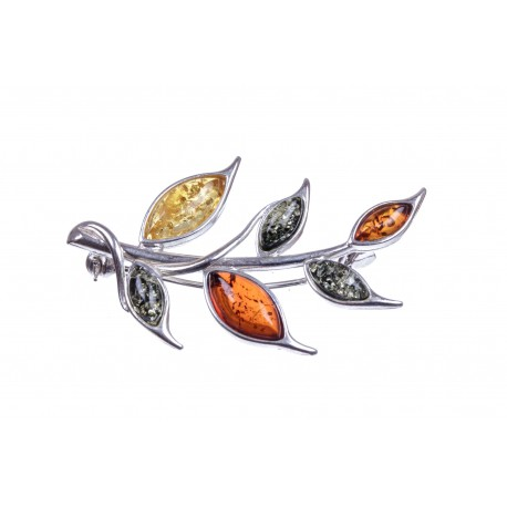 Silver brooch decorated with multicoloured amber