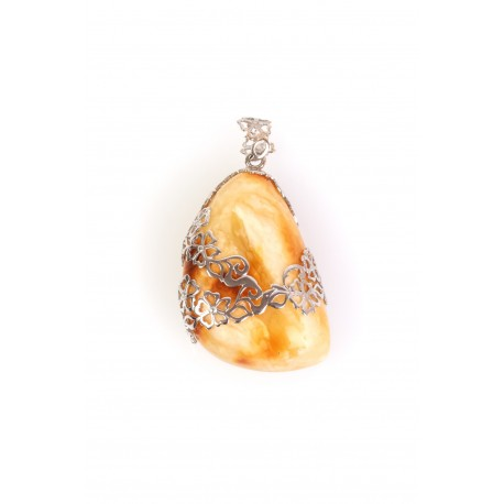 Massive amber pendant decorated with silver flowers