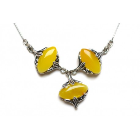 Cognac-colored oval amber pieces and stylized flower petals