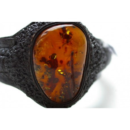 Black leather bracelet with transparent cognac-colored amber