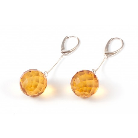 Silver earrings with round-diamond polished amber