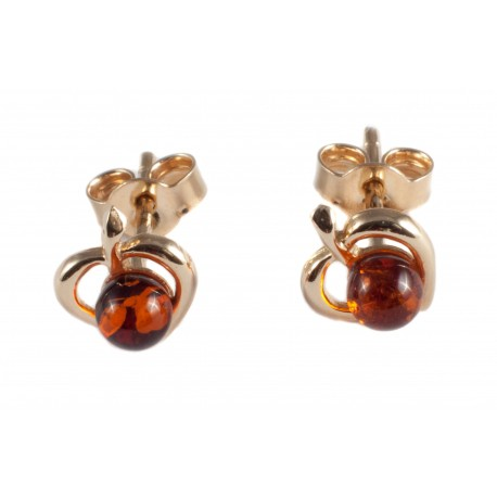 Golden earrings with cognac-color amber