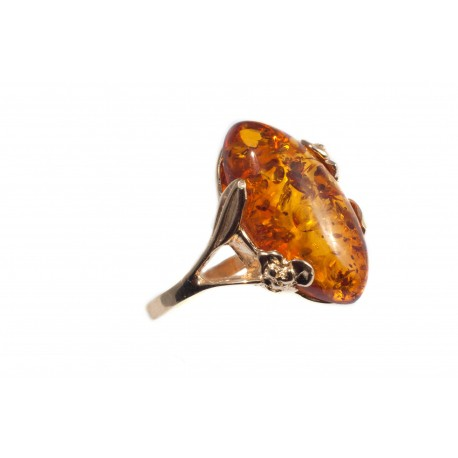 Golden ring with amber