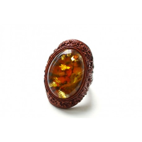 Light brown color ring with dark cognac-colored amber