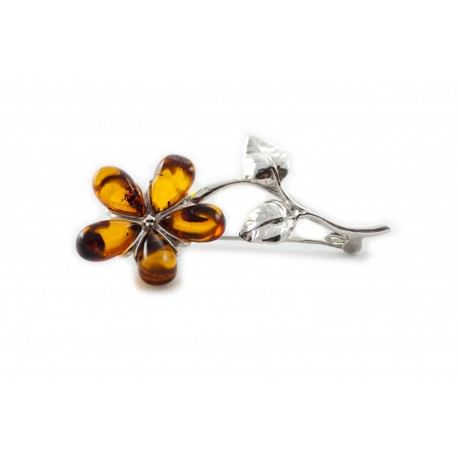 Silver brooch with cognac-colored amber