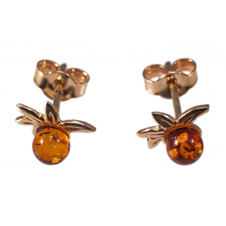 Golden earrings with cognac-colored amber