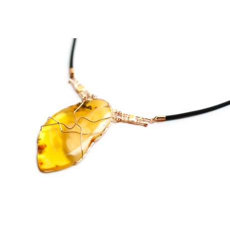 Golden necklace of amber and caoutchouc