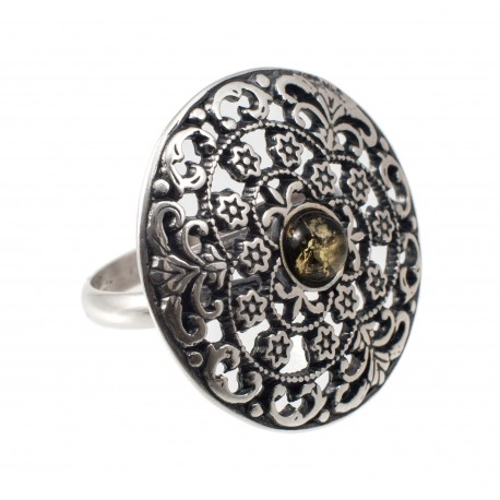 Round silver ring with green amber eye
