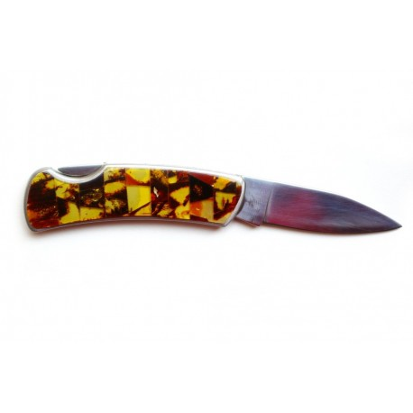 Knife decorated with mottled amber mosaic