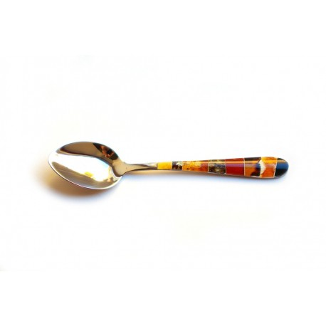 Dessert spoon decorated with amber