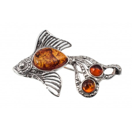 Silver brooch with cognac amber