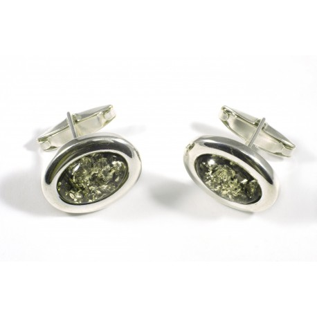 Silver cufflinks of green amber
