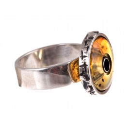 Silver ring with transparent brown amber
