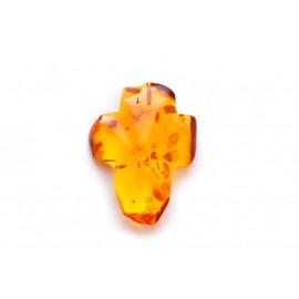 Transparent yellowish amber cross