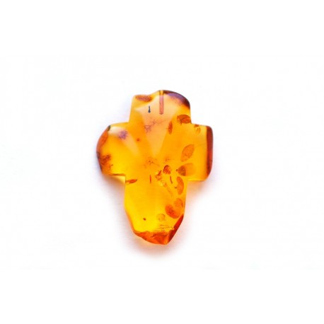 Transparent yellowish amber cross
